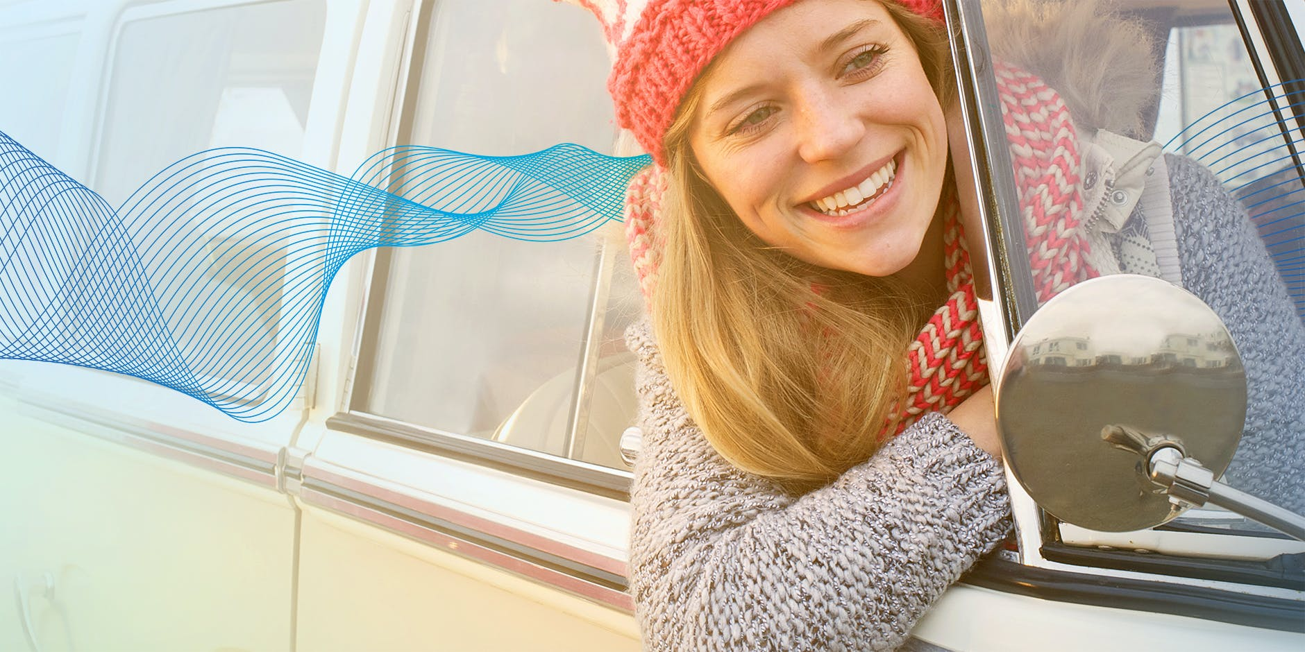 Woman smiling with head outside car window otrivine