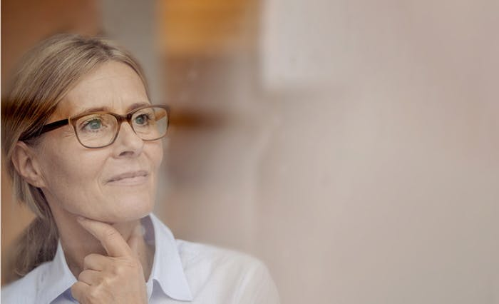 Woman with glasses thinking
