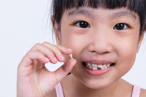 Should You Help Your Child Pull Out a Loose Tooth?