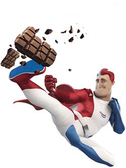 Der Superheld  von Odol-med3 wie er in der Luft einer Tafel Schokolade einen Tritt verpasst und diese in viele Stücke zerbricht.