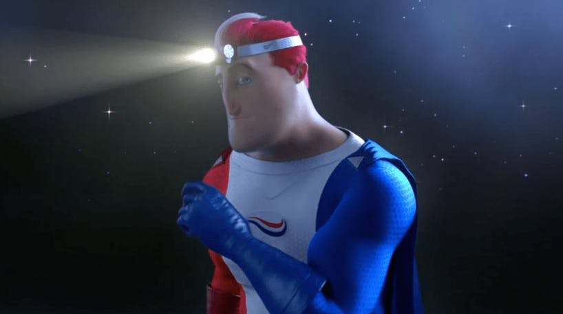 Captain Aqaufresh standing in darkness with a headlamp, shining a light on teeth whitening.