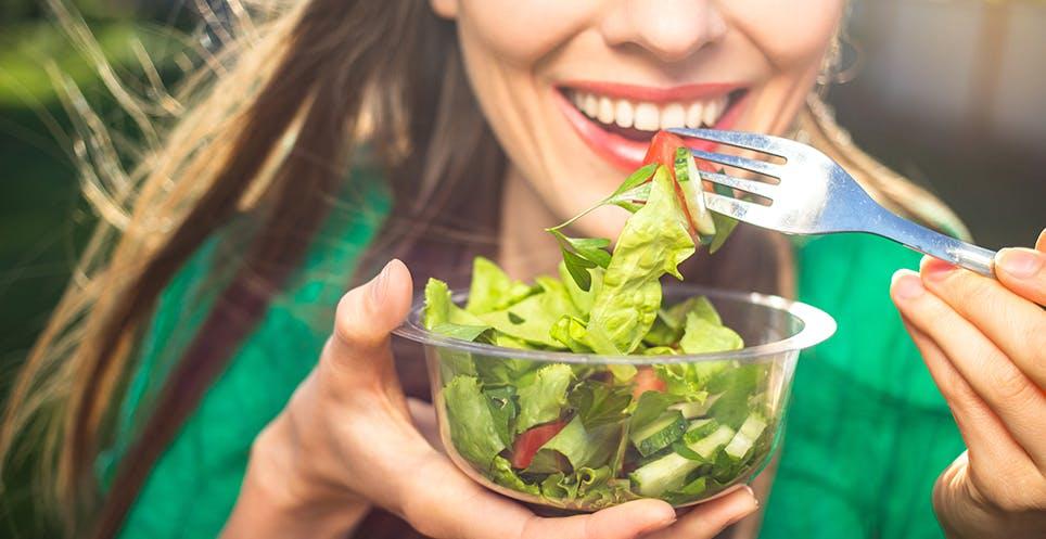 Woman eating low fodmap salad