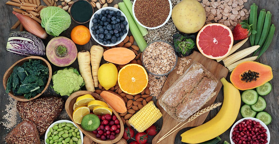 High fiber foods including beans, nuts, whole grains and some fruits and vegetables.