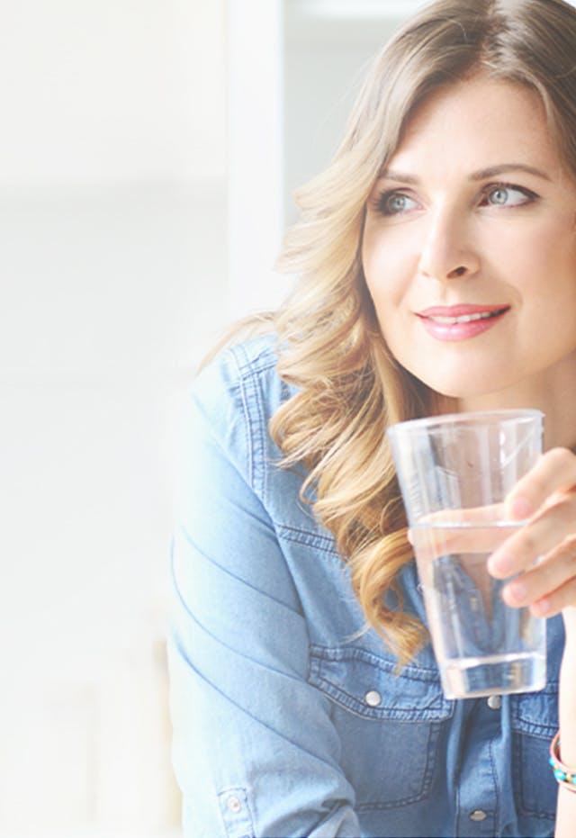 Woman Drinking Benefiber