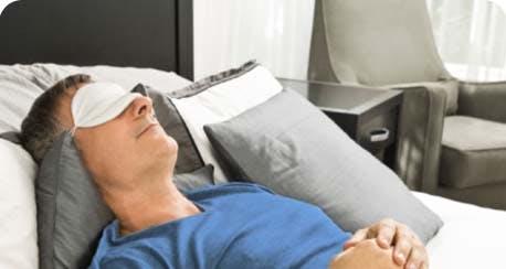 man sleeping with eye-mask