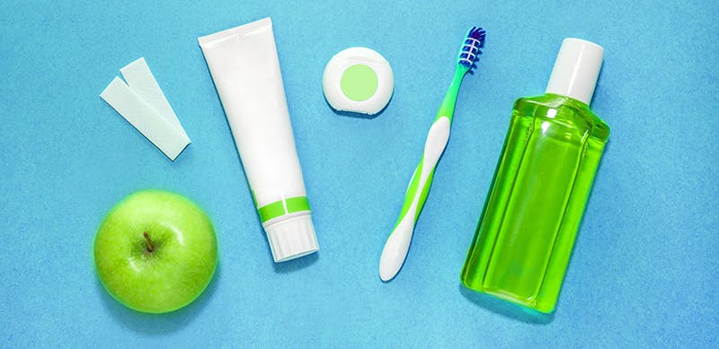 Green apple beside a white and green travel items
