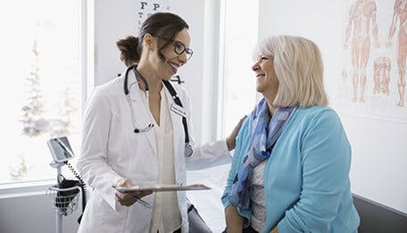 Doctor and patient discussing dry mouth causes
