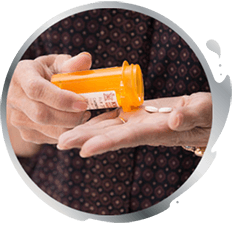 A man pouring pills out of bottle into his hand
