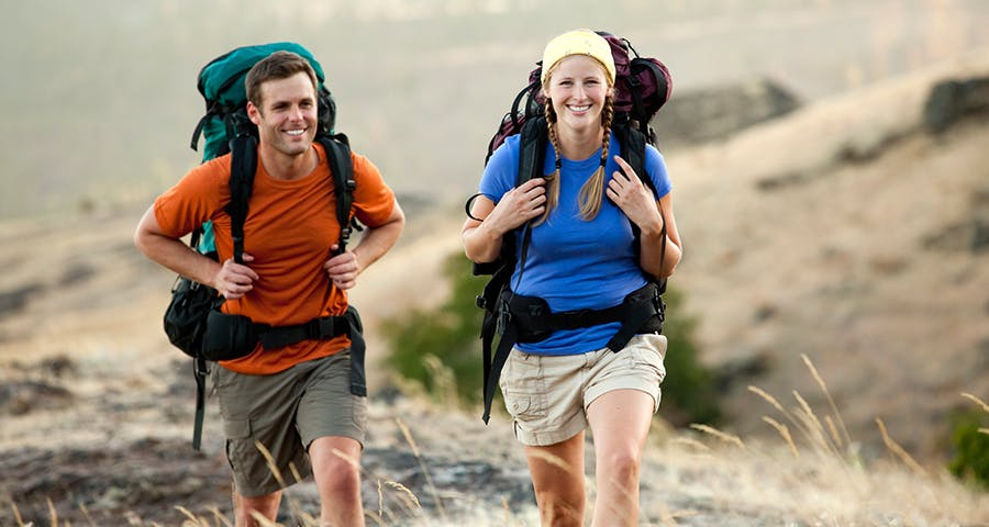 smiling couple hiking