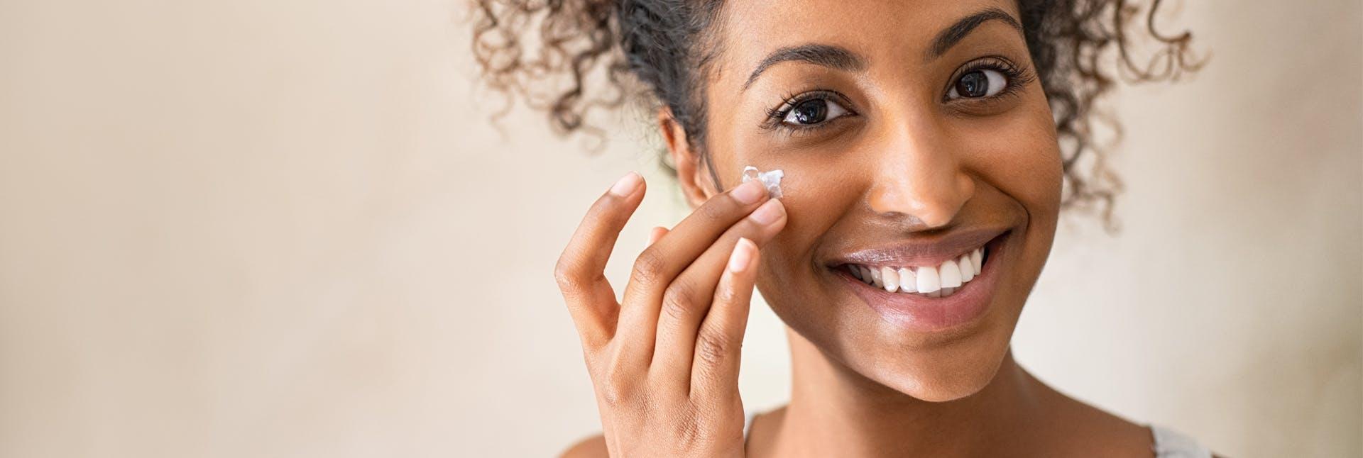 Woman putting on skin care