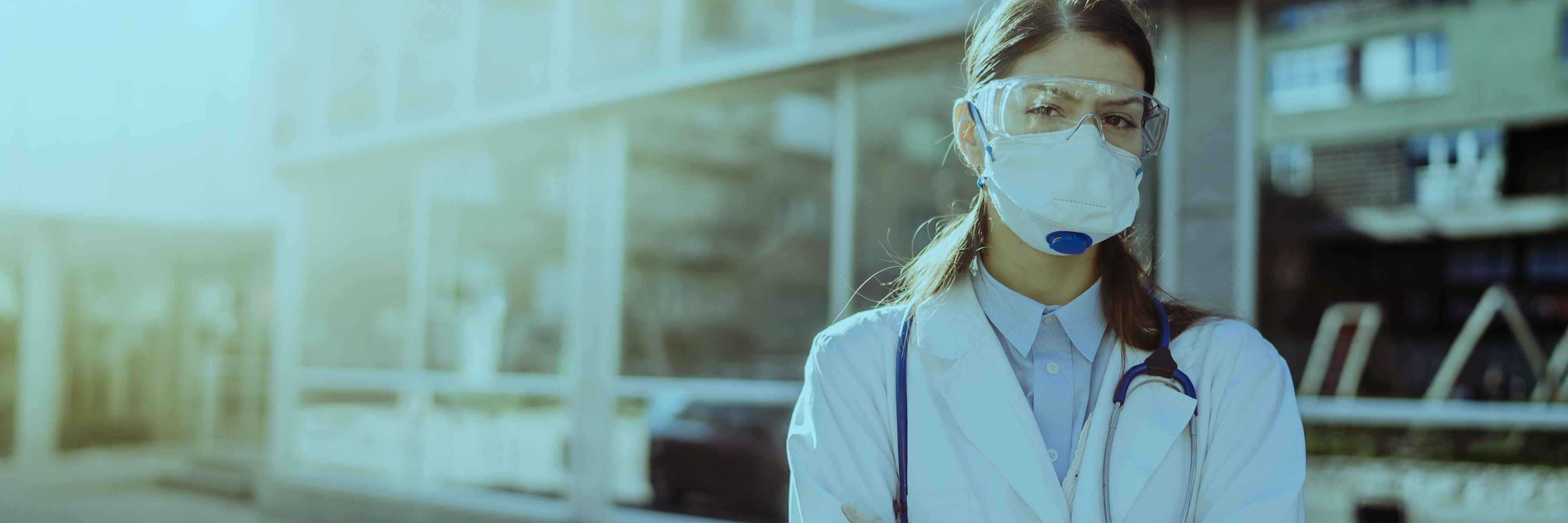 A female health worker wears the kind of personal protective equipment (PPE) that Direct Relief, helped by GSK, can provide