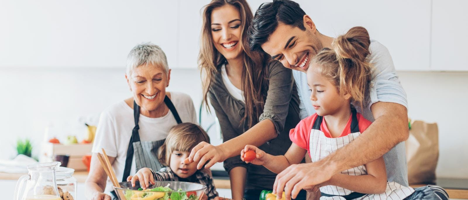 A happy family cooking in the kitchen
