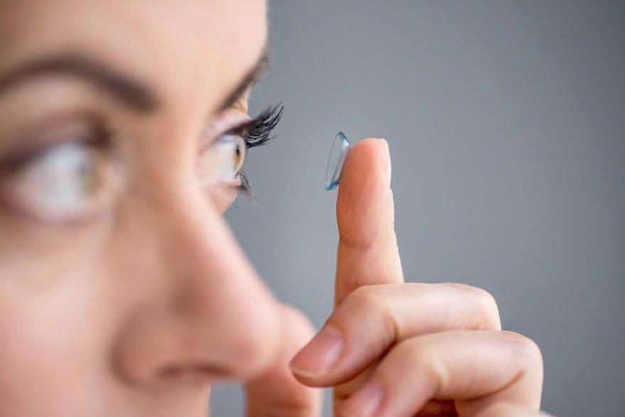Lady putting contact lens thumbnail