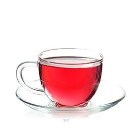 Hot Tea Pink Edition drink in clear teacup