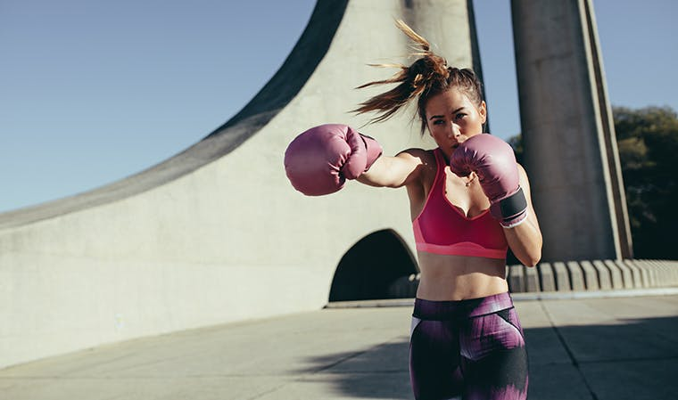 Person kickboxing outdoors