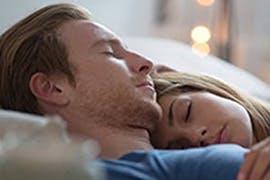 women sleeping and alarm clock