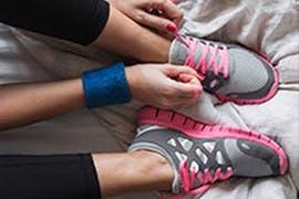 women tying her sneakers