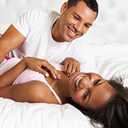 man and women laughing