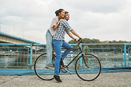 man and women on a bike