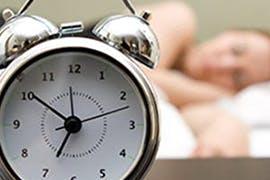 alarm clock and person sleeping