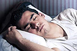 man asleep on pillow