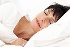 women sleeping on a pillow