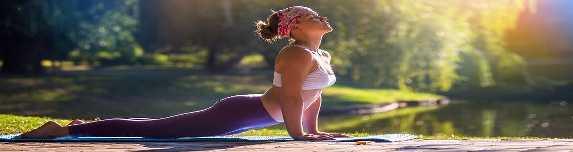 Women doing yoga to relieve stress