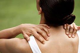 women holding each side of neck
