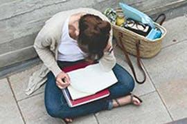 women writing a headache diarty
