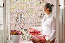 women sitting in window