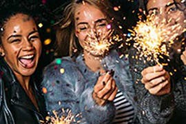 three women with sparklers