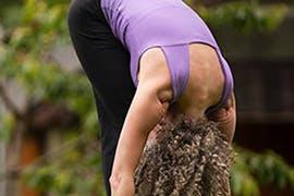 women in yoga pose outside
