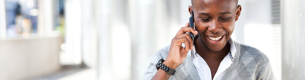 Young man talks to his mom on the phone to reduce stress