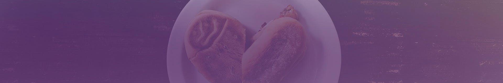 Sandwich shaped lke a heart on a plate.