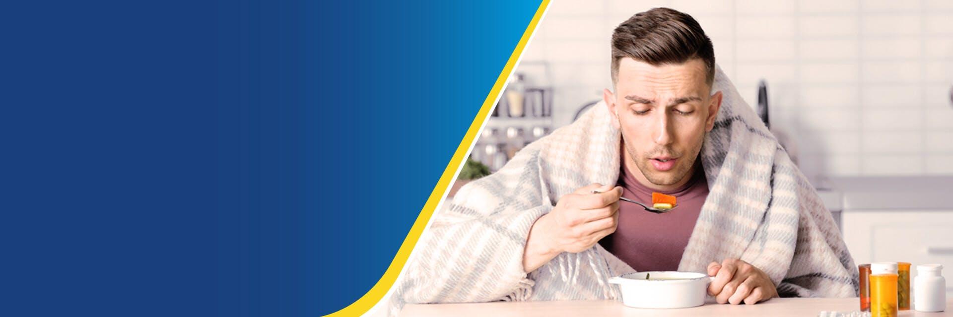 Sick man eating soup