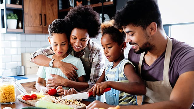 A family is cooking a healthy breakfast together.