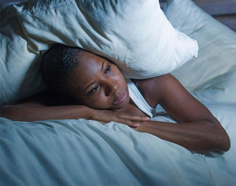 What to Look For in a Bed and a Pillow If You Have Acid Reflux