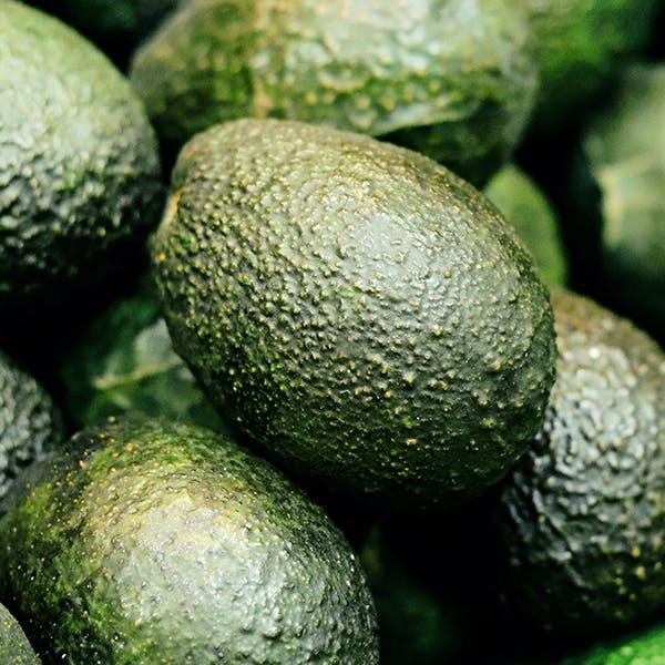 Close up of avocados.