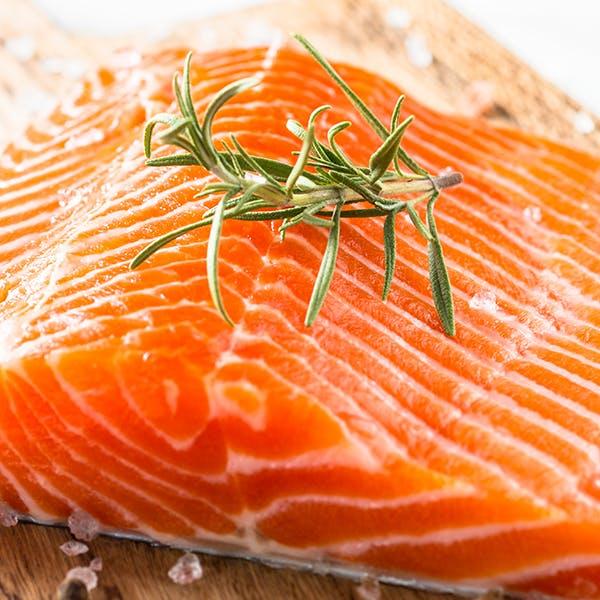 Fresh salmon being prepared.