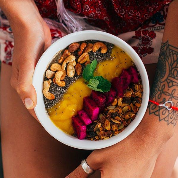 Woman holding acai bowl