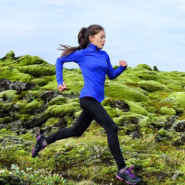 Woman running on a mountain.