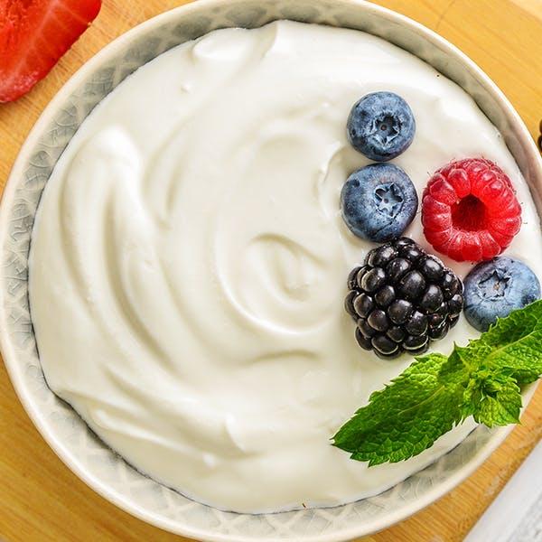 A bowl of plain low-fat yoghurt.