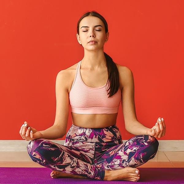 Woman sitting in a meditative yoga pose