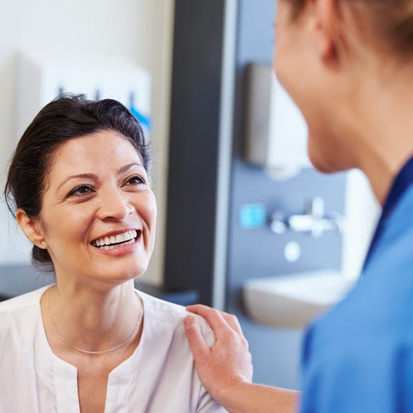 Female patient being reassured by doctor