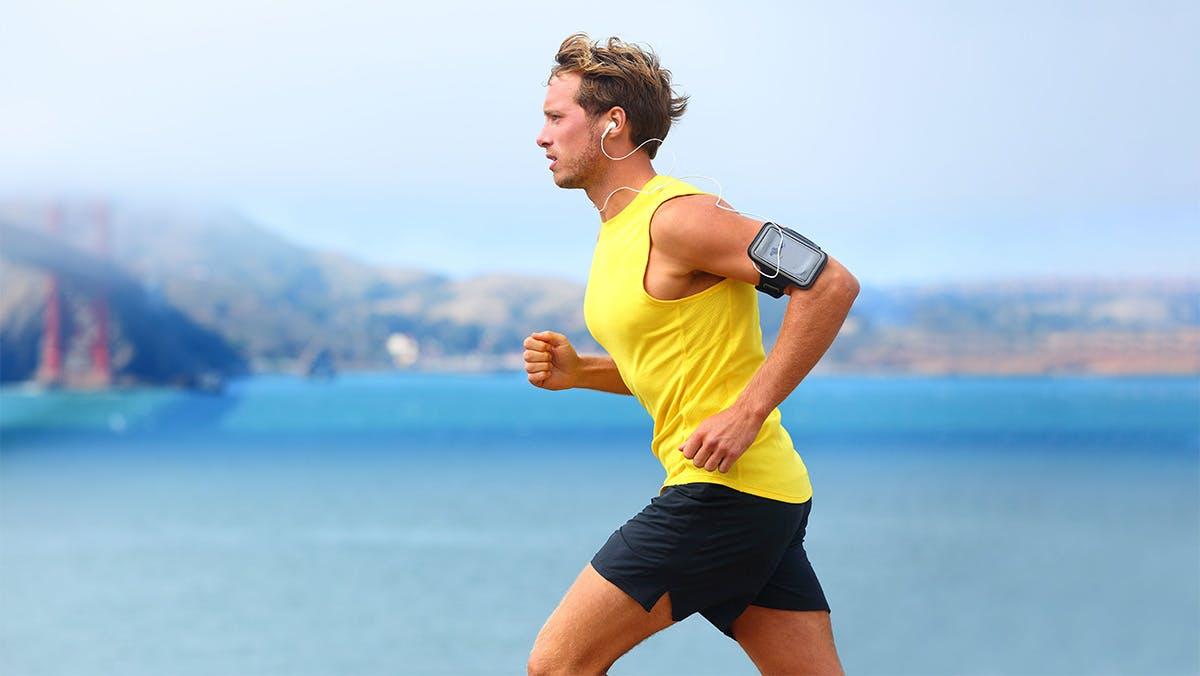 Man running next to water