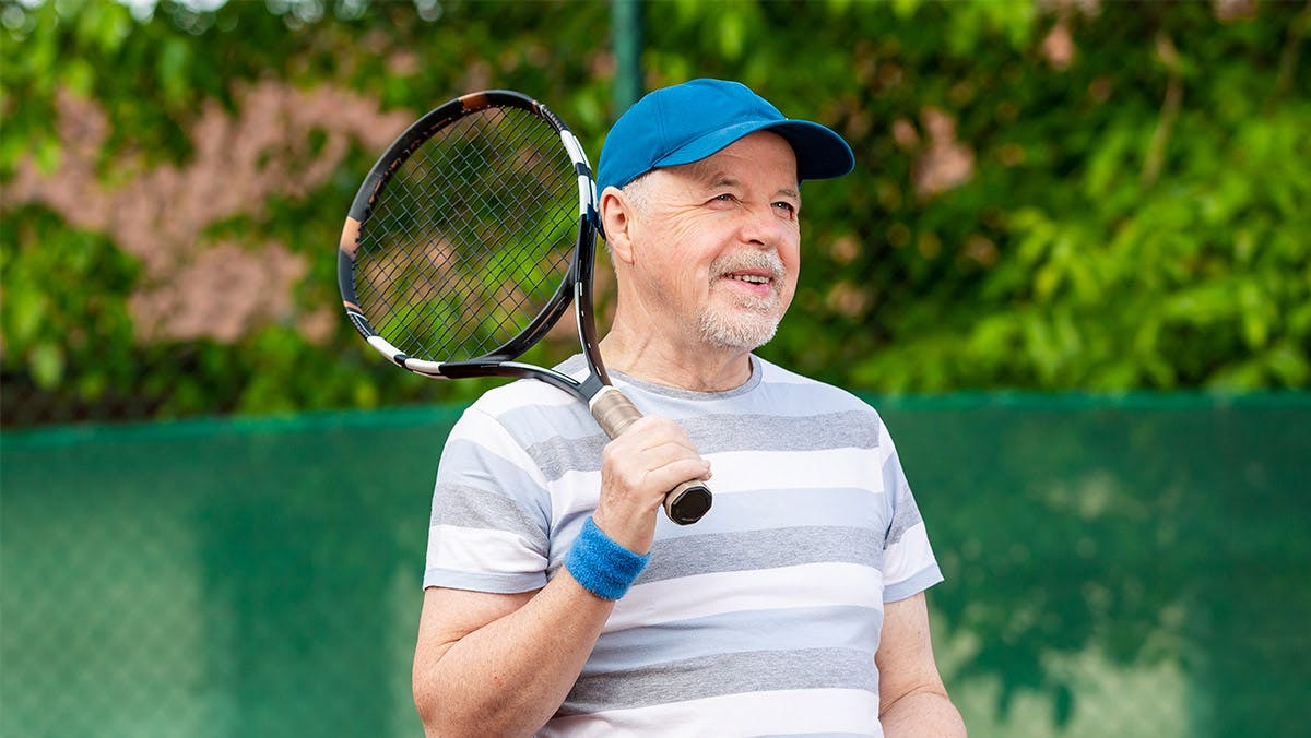 middle-aged man playing tennis