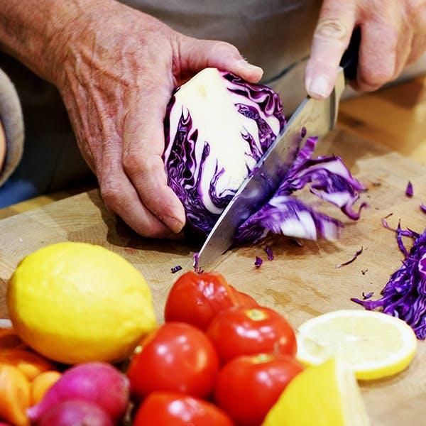 Man cutting purple cabbage