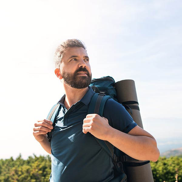 Man with a backpack hiking outside