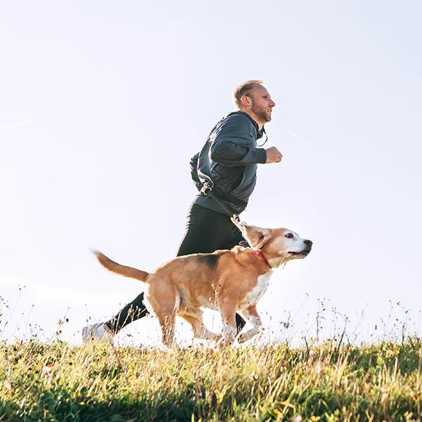 Man running on mountain trail
