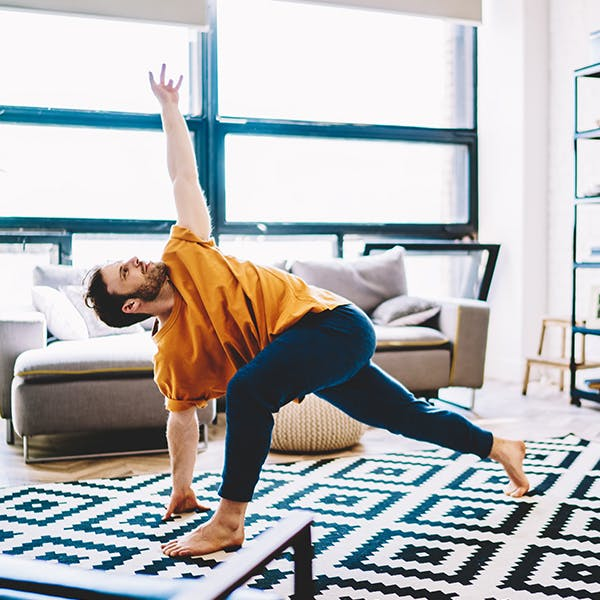 Person doing yoga stretches in their living room